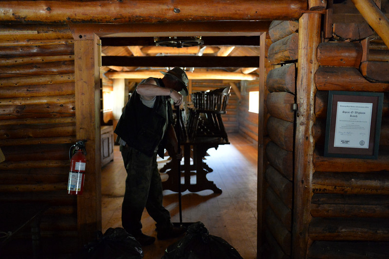 Justin Sheely | The Sheridan Press<br /> A Sheridan College employee sweeps the floor in the lodge at Spear-O Wigwam in the Bighorn National Forest Thursday, June 28, 2018. The NWCCD board approved the potential sale on June 20 of Spear-O Wigwam, a 67,850-acre area in the Bighorn Mountains. The college leased the property since 2011 and used it for summer education programs and performances.