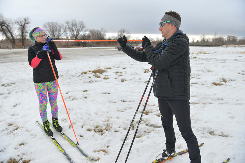 Justin Sheely | The Sheridan Press<br /> <br /> Ali Magelky, left, holds up her pole for ski coach John Kirlin to fix the basket during cross-country skiing practice at South Park Tuesday, Jan. 30, 2018. Magelky is the sole skier on the new Antelope Butte Foundation Nordic Club and set a goal to qualify for the Junior National Championships during her high school career.