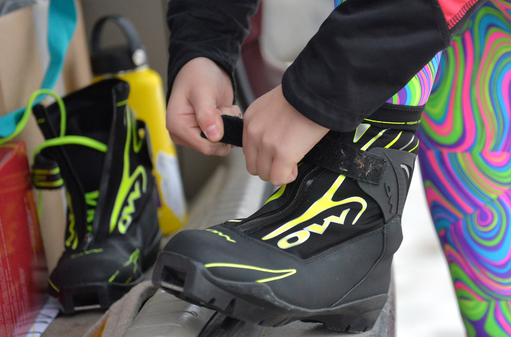 Justin Sheely | The Sheridan Press<br /> <br /> Sheridan High School freshman Ali Magelky straps on her ski boots during cross-country skiing practice at South Park Tuesday, Jan. 30, 2018. Magelky is the sole skier on the new Antelope Butte Foundation Nordic Club and set a goal to qualify for the Junior National Championships during her high school career.