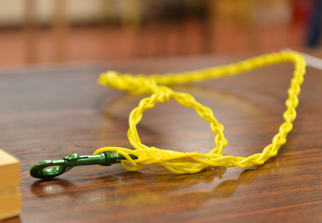 Justin Sheely | The Sheridan Press<br /> A proposed dog leash made of surface tie-in lines is seen during a presentation at Decker Mine Tuesday, April 11, 2018. Decker Mine uses at least 150,000 feet of plastic line for blasting each year. The mining company approached Sheridan County School District 2 student to come up with ideas for uses of the lines to reduce waste.