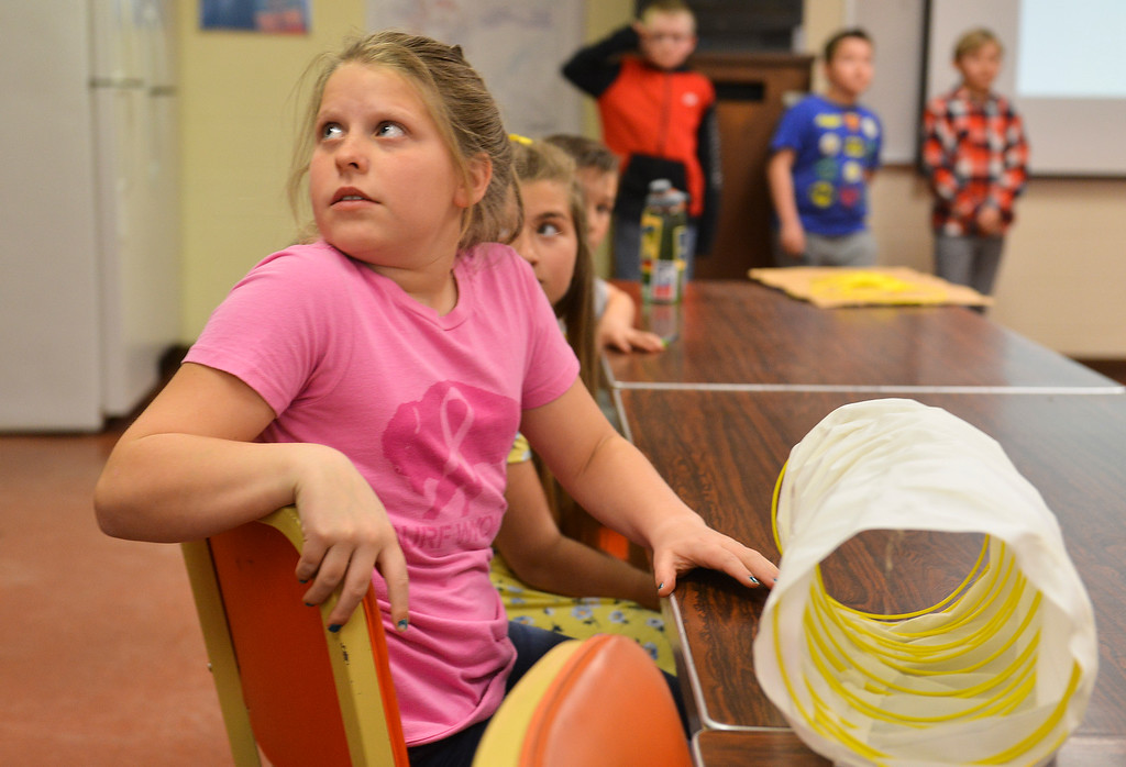 Justin Sheely | The Sheridan Press<br /> Highland Park fifth-grader Danielle Gilbert looks on during a presentation at Decker Mine Tuesday, April 11, 2018. Decker Mine uses at least 150,000 feet of plastic line for blasting each year. The mining company approached Sheridan County School District 2 student to come up with ideas for uses of the lines to reduce waste.