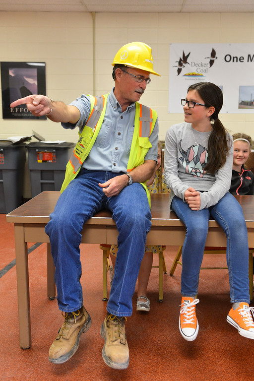 Justin Sheely | The Sheridan Press<br /> Decker Mine health and safety manager Don Kollekowski visits with fifth-grader Makena Mowry at Decker Mine Tuesday, April 11, 2018. Decker Mine uses at least 150,000 feet of plastic line for blasting each year. The mining company approached Sheridan County School District 2 student to come up with ideas for uses of the lines to reduce waste.