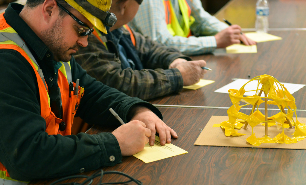 Justin Sheely | The Sheridan Press<br /> Maintenance supervisor Erick Nyback takes notes as students give their presentation for alternative uses of surface tie-in lines at Decker Mine Tuesday, April 11, 2018. Decker Mine uses at least 150,000 feet of plastic line for blasting each year. The mining company approached Sheridan County School District 2 student to come up with ideas for uses of the lines to reduce waste.