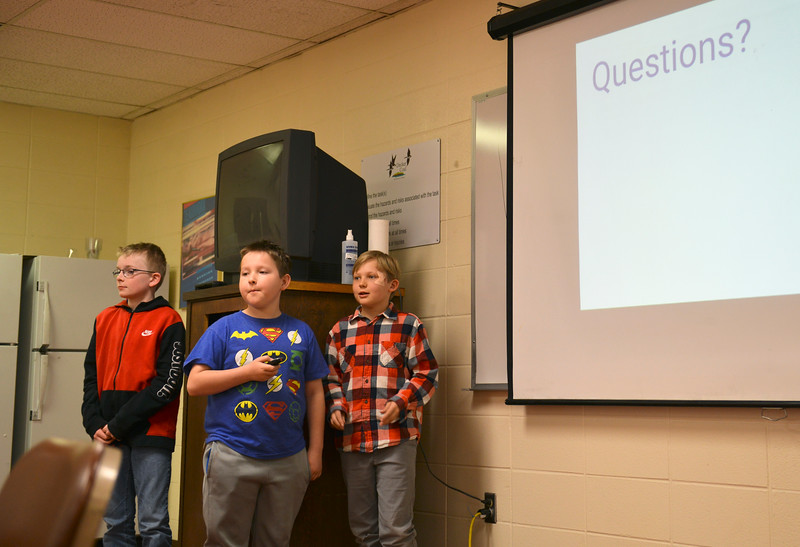 Justin Sheely | The Sheridan Press<br /> Fourth-graders, from left, Nicholas Matheney, Gideon Smith and Owen Porterfield wrap up their presentation for alternative uses of surface tie-in lines at Decker Mine Tuesday, April 11, 2018. Decker Mine uses at least 150,000 feet of plastic line for blasting each year. The mining company approached Sheridan County School District 2 student to come up with ideas for uses of the lines to reduce waste.