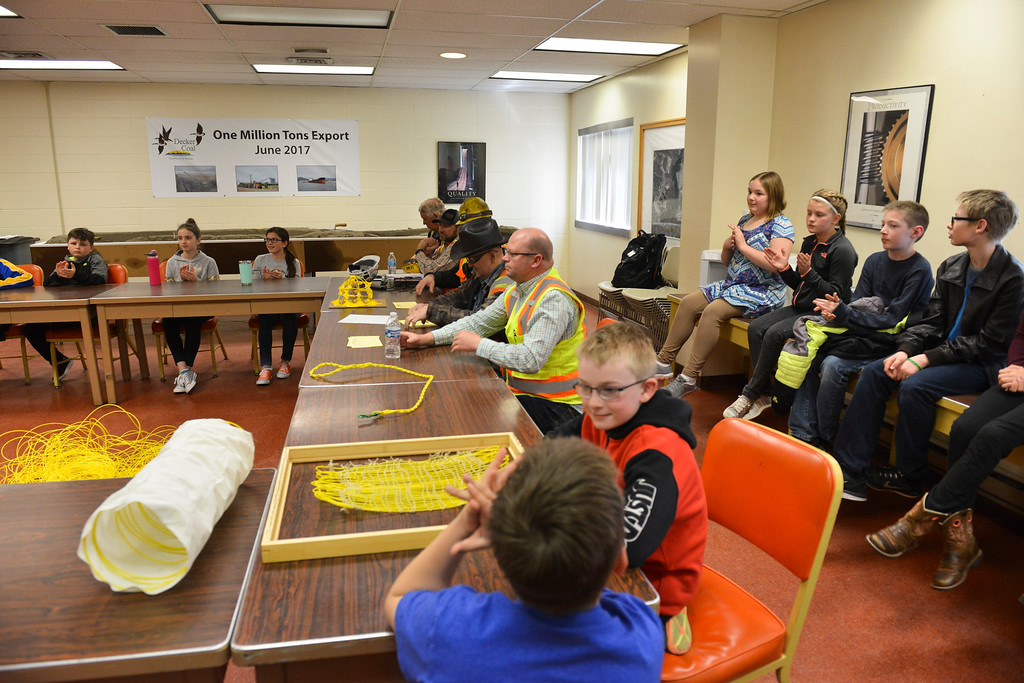 Justin Sheely | The Sheridan Press<br /> Elementary students and mine employees listen to a presentation at Decker Mine Tuesday, April 11, 2018. Decker Mine uses at least 150,000 feet of plastic line for blasting each year. The mining company approached Sheridan County School District 2 student to come up with ideas for uses of the lines to reduce waste.