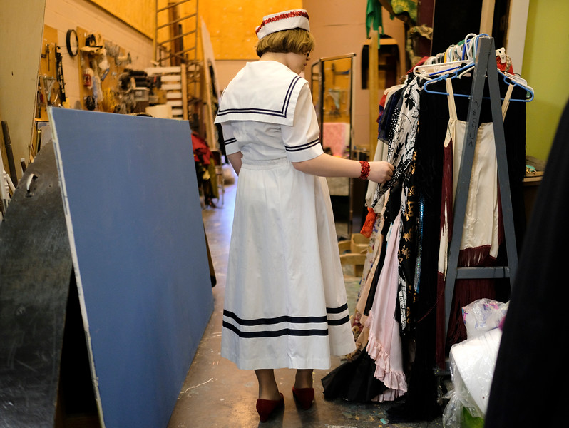 "Justin Sheely | The Sheridan Press<br /> Sophomore Brie Marcus looks at the costumes during a dress rehearsal for ""The Boyfriend"" at Sheridan High School Tuesday, Feb. 27, 2018. The musical shows at Sheridan High School March 1 - 3 at 7:15 p.m. and Sunday, March 4 at 2 p.m."