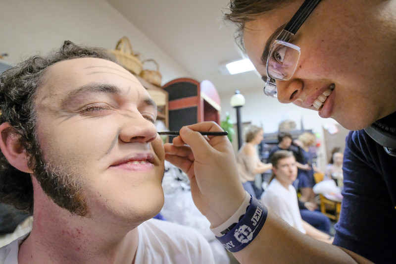 "Justin Sheely | The Sheridan Press<br /> Senior Race Johnston, left, holds still as Emma Manor applies aging makeup during a dress rehearsal for ""The Boy Friend"" at Sheridan High School Tuesday, Feb. 27, 2018. The musical shows at Sheridan High School March 1 - 3 at 7:15 p.m. and Sunday, March 4 at 2 p.m."