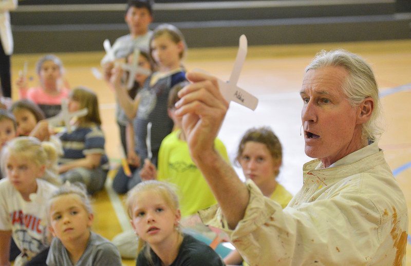 Justin Sheely | The Sheridan Press<br /> Australia native Paul Taylor demonstrates how to throw a paper boomerang at Arvada-Clearmont school Wednesday, May 2, 2018. Australian-American educator, artist and ambassador Paul Taylor visited Clearmont for two days last week to talk about aboriginal culture and teach students how to make a didgeridoo and boomerang.