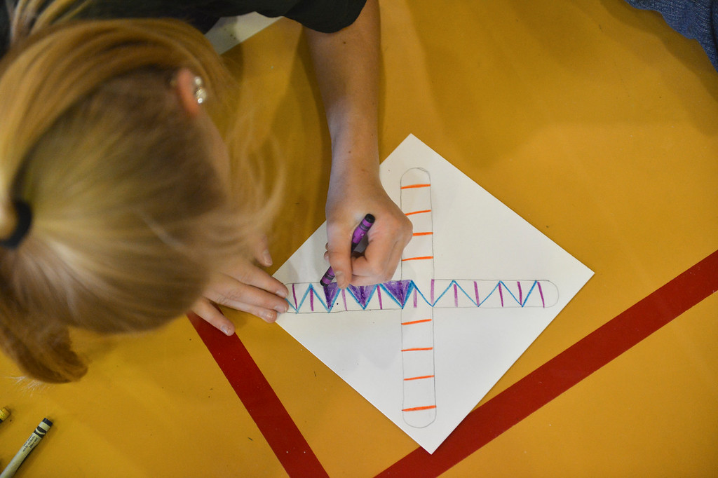 Justin Sheely | The Sheridan Press<br /> A student draws a paper boomerang at Arvada-Clearmont school Wednesday, May 2, 2018. Australian-American educator, artist and ambassador Paul Taylor visited Clearmont for two days last week to talk about aboriginal culture and teach students how to make a didgeridoo and boomerang.