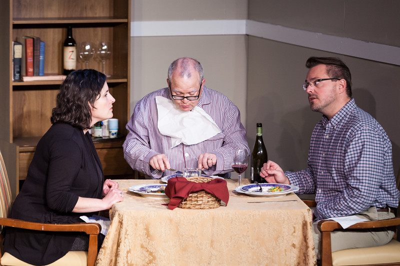 "Tibby McDowell | The Sheridan Press<br /> Dimitra Dugal, as Anne, left, has a heated argument with her partner Pierre, by Aron Linden, right, while Scott Bateman as Andre continues to eat his dinner during a rehearsal of ""The Father"" at the Carriage House Theater Thursday, Jan. 11, 2018."