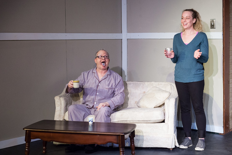 "Tibby McDowell | The Sheridan Press<br /> Scott Bateman as Andre, left, sticks his tongue out for his care provider, right, by Jamie Lance, to prove he has swallowed his little blue pill.  The Sheridan Civic Theatre Guild held rehearsal of ""The Father"" at the Carriage House Theater Thursday, Jan. 11, 2018."