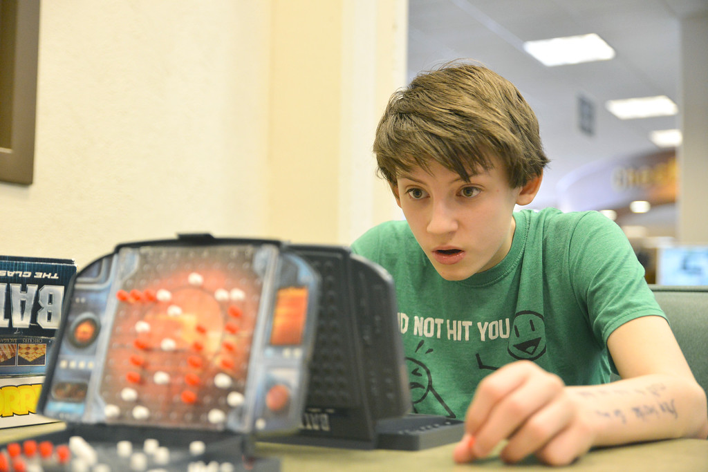 Justin Sheely | The Sheridan Press<br /> Thirteen-year-old Keaton Van Norman studies the board as he plays Quinton Brooks at a game of Battleship at the Sheridan County Fulmer Public Library Saturday, March 31, 2018.
