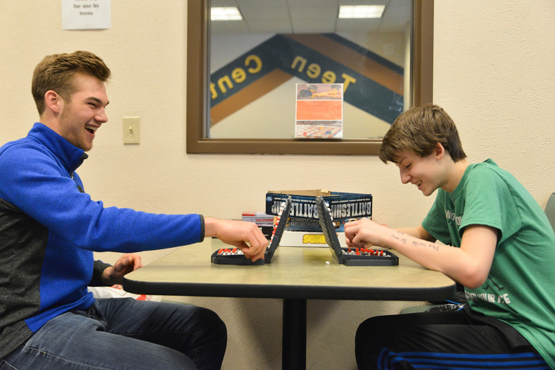 Justin Sheely | The Sheridan Press<br /> Quinton Brooks, left, makes a move against his little Keaton Van Norman, 13, at a game of Battleship at the Sheridan County Fulmer Public Library Saturday, March 31, 2018. Brooks and Van Norman have been friends for more than two years through Wyoming Big Brothers Big Sisters.