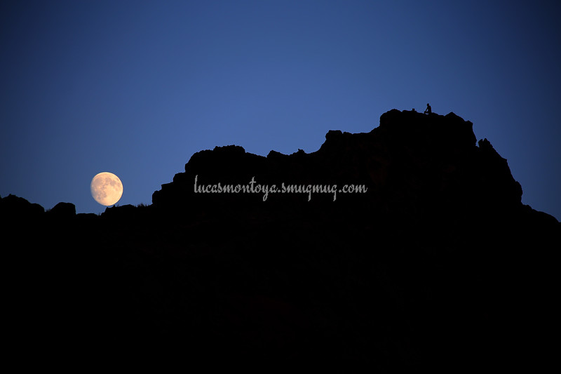 Moon rising over Garden of the Gods rock formation with silhouetted man, 25 Sep 2015 - Colorado Springs, CO