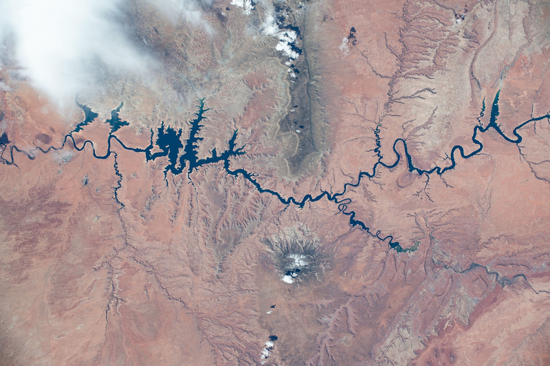 Canyon created by 5 million years of river erosion, then flooded to make a reservoir. Concerns with drop in water level due to continued dry seasons. ISS over southwest United States. (ANSWER: Glen Canyon/Lake Mead in the southwestern United States)