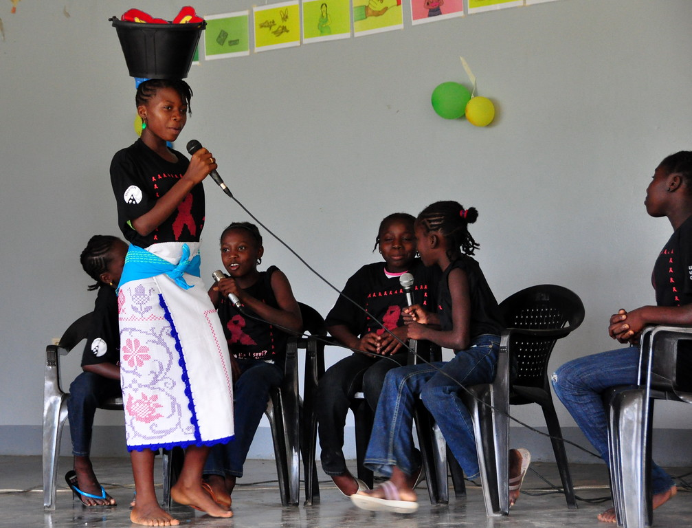 A group of Peace Corps volunteers living along the Upper Suriname River collaborated with local school children to hold a World AIDS Day celebration in the village of Tutubuka. With aid from UNICEF and PEPFAR, dozens of volunteers around the country were able to join with their communities to hold similar events.