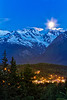 The full moon sets over the city of Haines and the Chilkat Mountains. Haines, Alaska