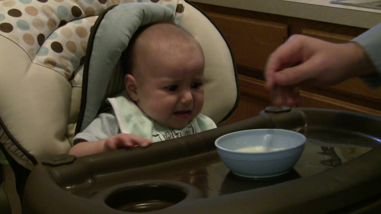 Evan having his first rice cereal.