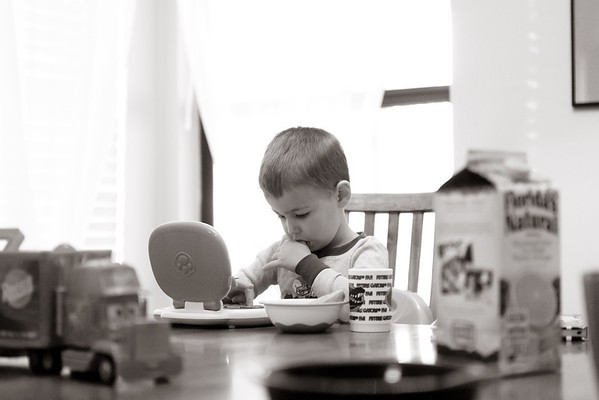 A quick email check during breakfast is a great way to start the day.  Evan's always a multitasker!