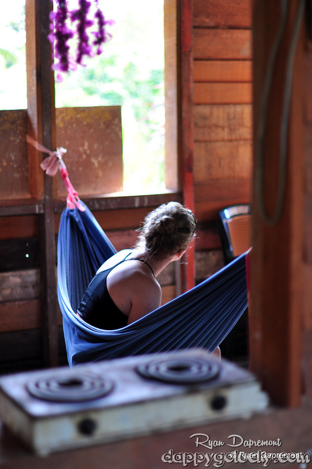 A Peace Corps Volunteer takes a break in a hammock during training.