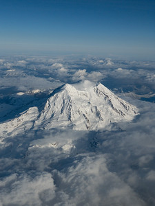 Mt. Rainier rising from the clouds