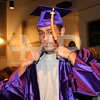Raul Cruz tries on his cap and gown