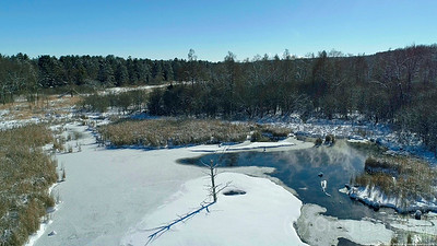 Over Nearly Frozen Pond North of Stillwater South of Marine by St. Croix River