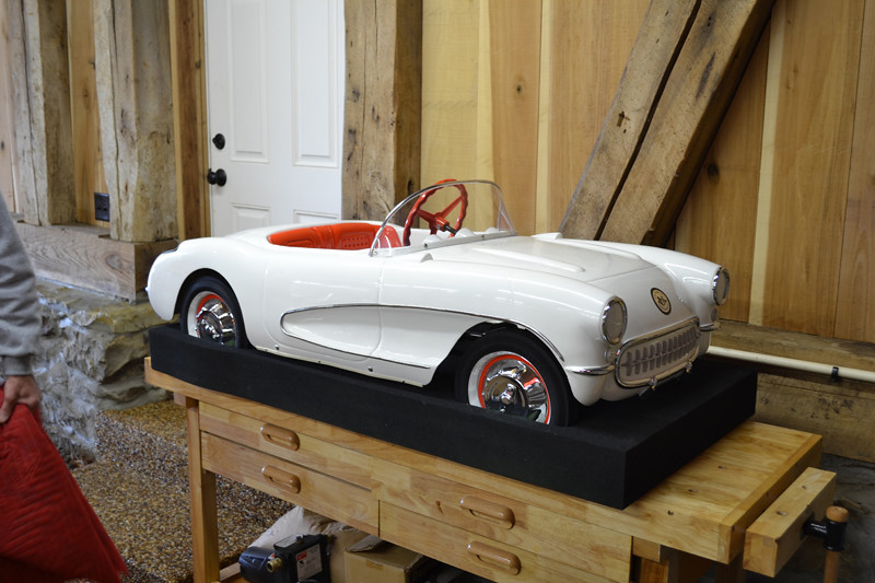 This is a plastic two-speed pedal car from the 50s.  Very cool, very valuable little auto.