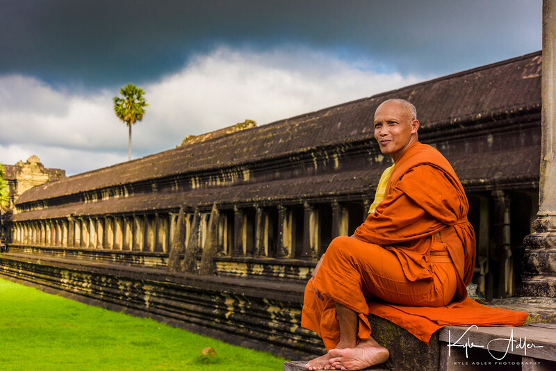 A monk pauses to reflect outside Angkor Wat.