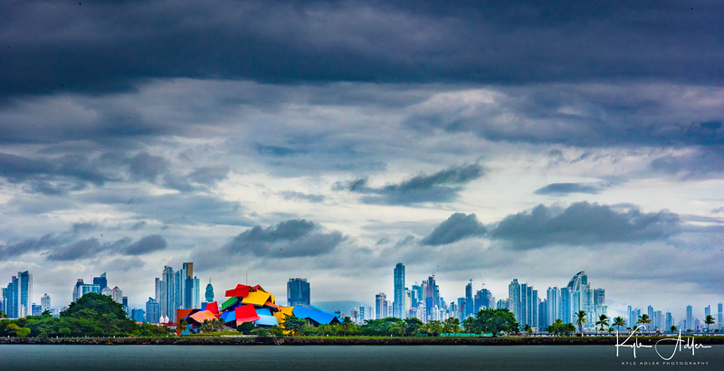 Setting sail on the Panama Canal, we pass Gehry's Biodiversity Museum with the Panama City skyline in the background.