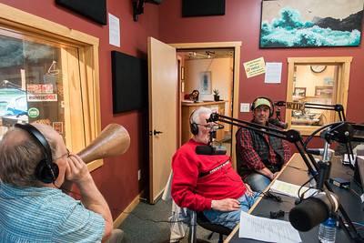 "BEHIND THE SCENES 00692  On Thursday, June 2nd, 2016 I was live on the air in Grand Marais, MN with 3 friends and fellow photographers as part of WTIP's First Thursday Community Conversations program.  Paul Sundberg, Tom Spence, Dave Brislance and myself got together to talk about cameras and our experiences photographing wildlife.  Visit the ""Media"" page of my website to listen to the program.  In the photo above that I took during the program, you can see Paul Sundberg demonstrating the use of his moose call (which can be heard about 41 minutes into the program)."