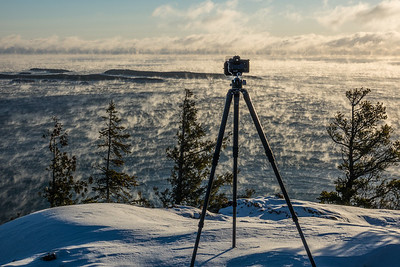 BEHIND THE SCENES 04017  December 2016 - Photographing Lake Superior Sea Smoke from the summit of Mt. Josephine in Grand Portage, MN.  Temperature was about 5 degrees below zero with 25 mile per hour winds.