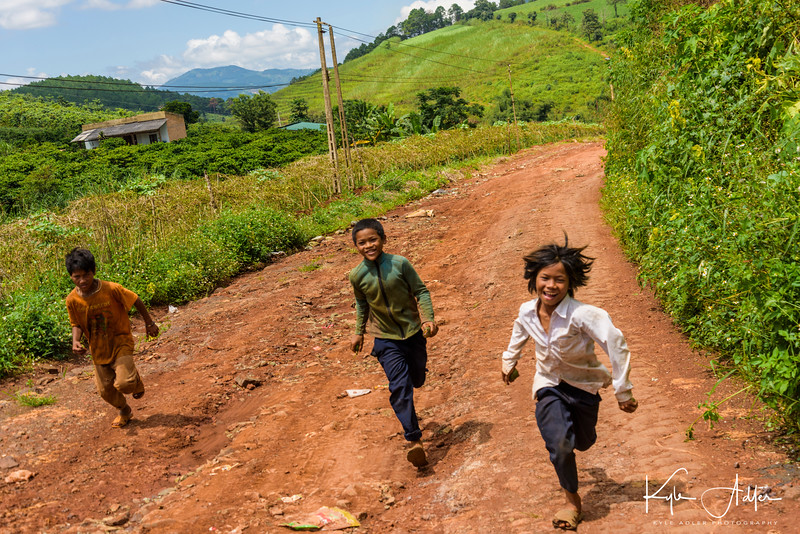 Kho Chil boys run after our tractor as we descend from Buon Chuoi Village.