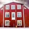 In Stykkisholmur we came across this curious house.  Its facade has windows at street level and a doorway at the second story level.