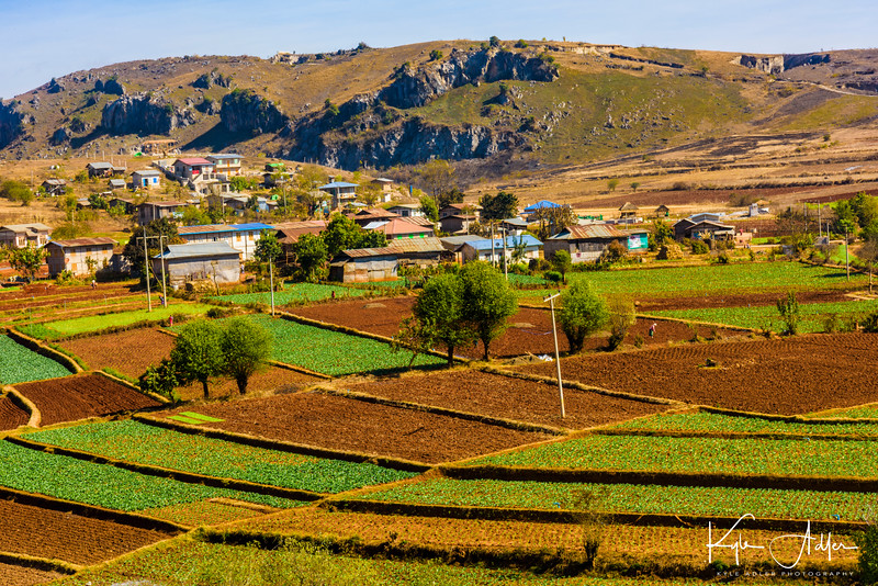 Colorful terracing characterizes the agricultural landscape as we travel overland from Kalaw to Myin Ma Htie village.