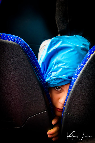 We shared a city bus with a group of schoolkids out on a field trip to visit the National Museum.  This little boy and I were playing a game of virtual peekaboo, resulting in this unorthodox portrait (also one of my favorites).