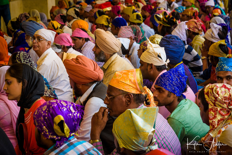People waiting for the next meal service at the Gurdwara Bangla Sahib Sikh temple in New Delhi.