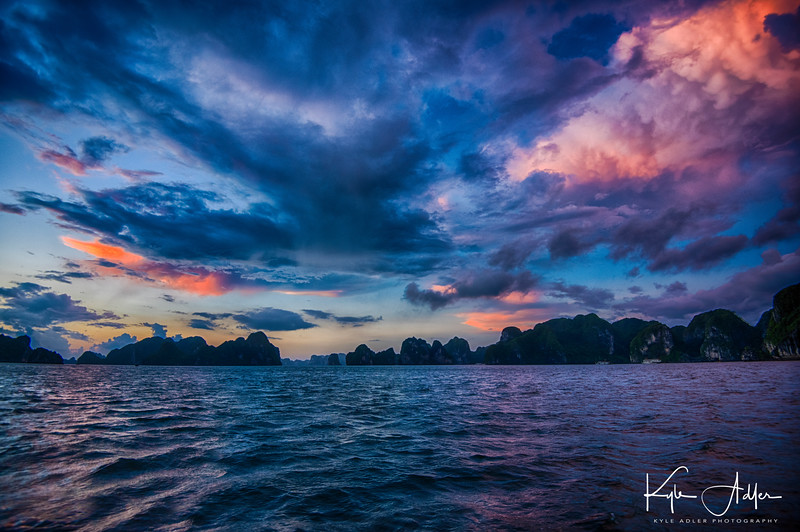 I hired the captain of our junk to take out the skiff at 5 AM in order to photograph sunrise on Halong Bay.