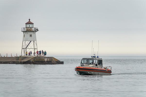 """Coast Guard Patrol and Grand Marais Lighthouse"""