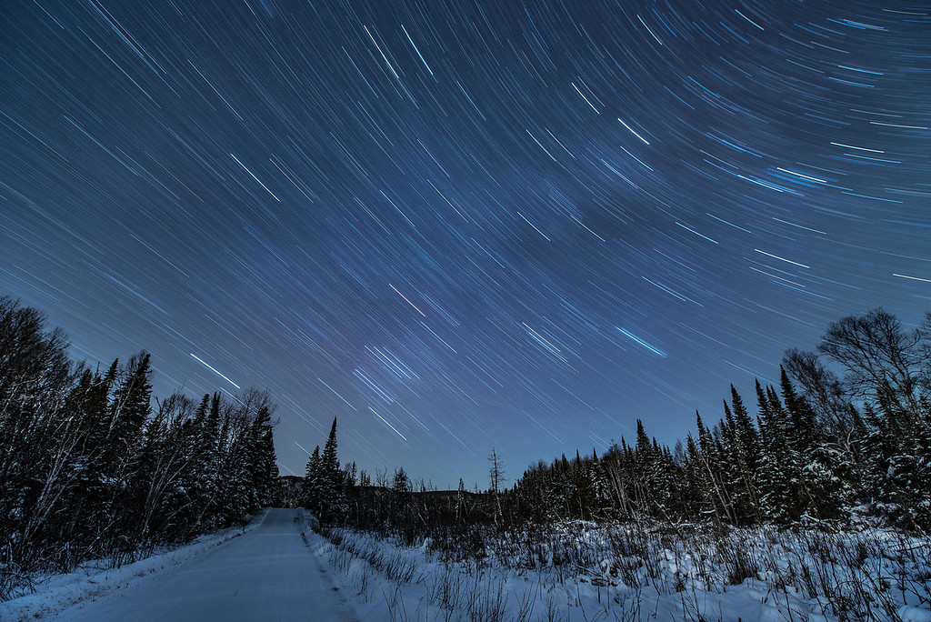 """STAR TRAILS 1960<br /> <br /> """"Old Highway Star Trails""""<br /> <br /> A 30 minute exposure of the night sky made on December 23, 2016.<br /> <br /> Old Highway 61 - Grand Portage, MN"""