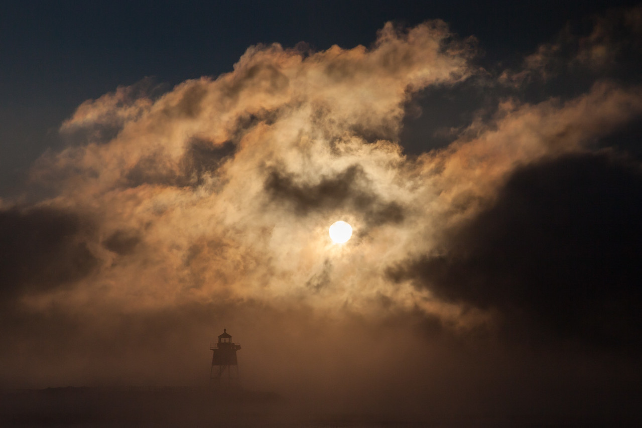"GRAND MARAIS 7609<br /> <br /> ""Sinister Sea Smoke""<br /> <br /> Sunrise over the Grand Marais lighthouse the morning of January 7, 2015."
