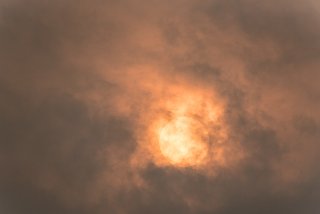 "ABSTRACT 6842<br /> <br /> ""Sunset Smoke Haze""<br /> <br /> July 2, 2015 - We have had a lot of haze in our sky lately, which I've heard is being caused by smoke coming from forest fires in Canada. It certainly has made for some interesting views of the sky lately.  A few nights ago I captured this photo of the sun a couple of hours before sunset.  The majority of the sky at the time was lacking any detail, but the area immediately surrounding the sun had some really interesting clouds.  Add to that the unique color at the time and I think it makes for an interesting shot."