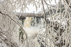 "PIGEON RIVER 03827<br /> <br /> ""High Falls through a Window of Ice""<br /> <br /> April 27, 2017 - Grand Portage State Park"