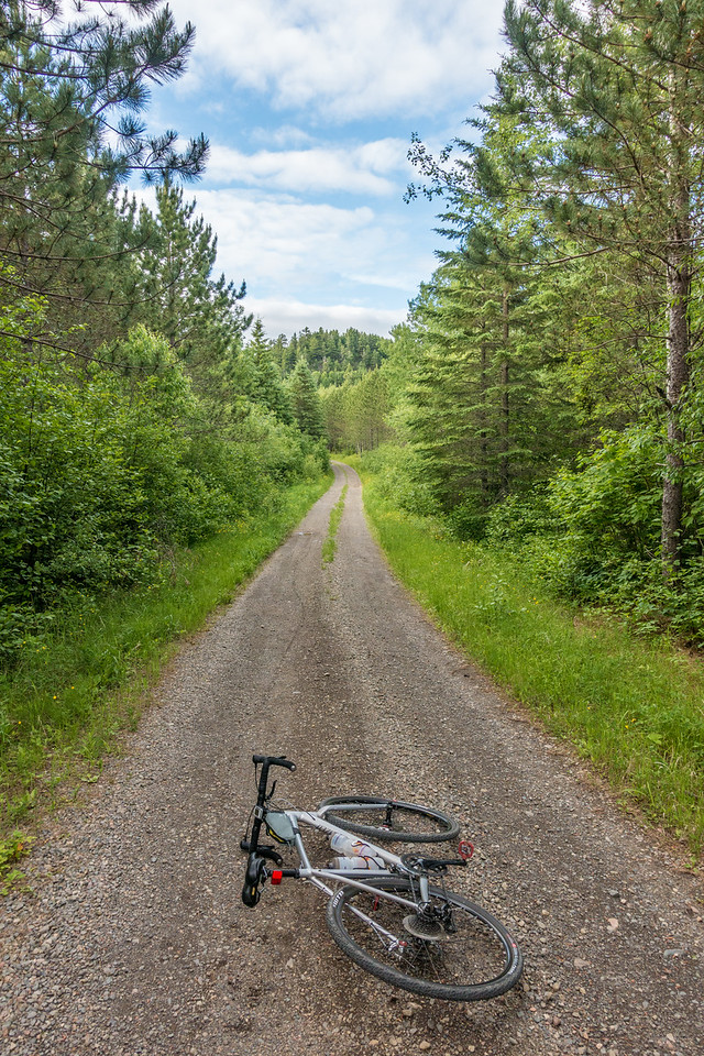 BIKING 01028<br /> <br /> One of my favorite stretches of gravel road...<br /> <br /> Grand Portage, MN