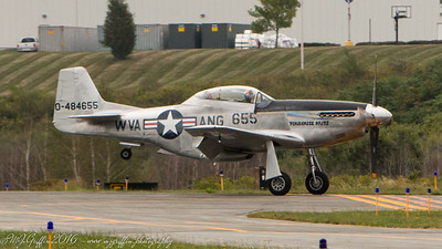 A WWII era P-51 Mustang landing at Beverly Airport. The plane is part of the Collins Foundation.
