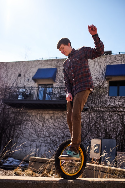 Jake's downtown Rockford senior  portrait shoot, featuring aggressive in-line skating photos, skateboarding lifestyle, and even a unicycle.