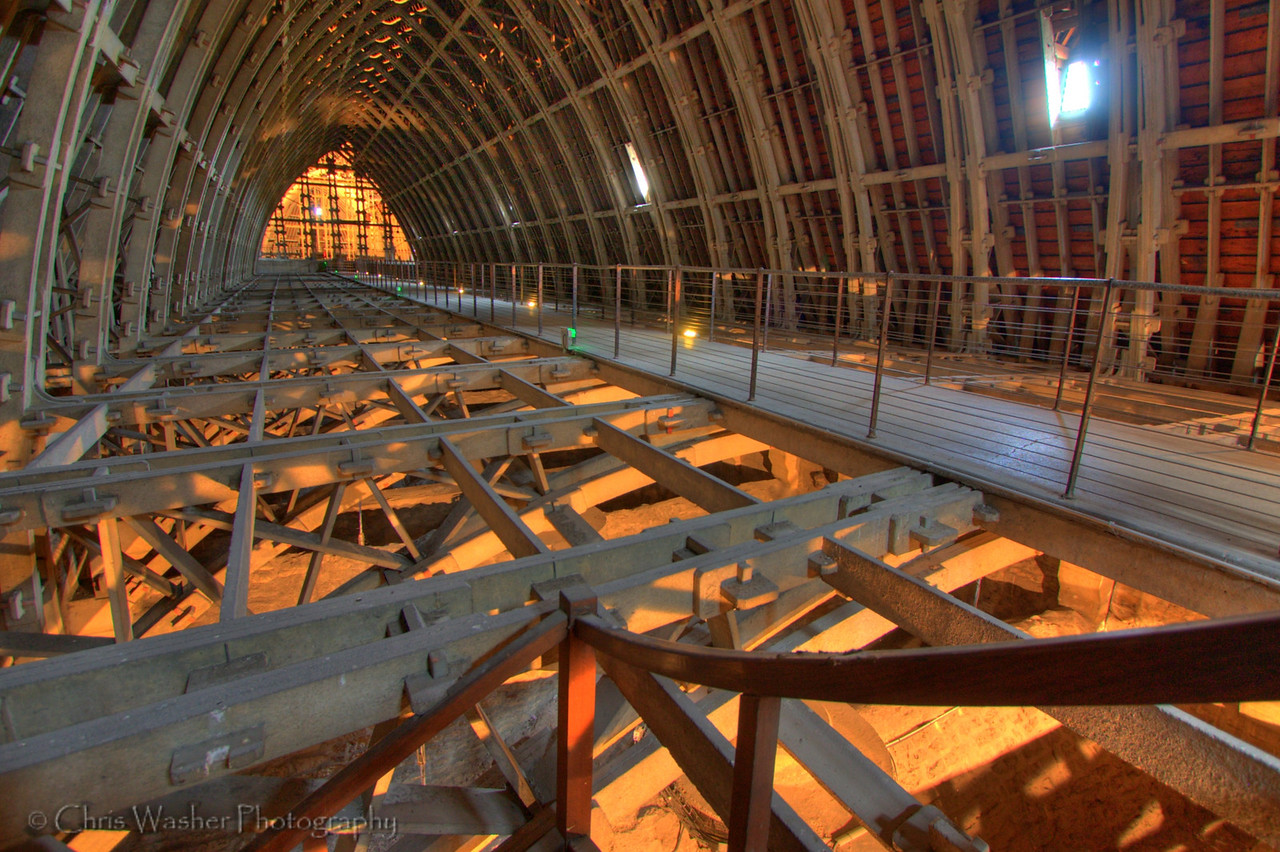 "Notre-Dame de Reims (Our Lady of Rheims) is the Roman Catholic cathedral of Reims, where the kings of France were once crowned.  This is the ""attic"" area between the ceiling and the roof.  The roof was replaced when the cathedral was rebuilt after WW1.  All the beams here are made of concrete, but are shaped and installed just like the original wood beams."