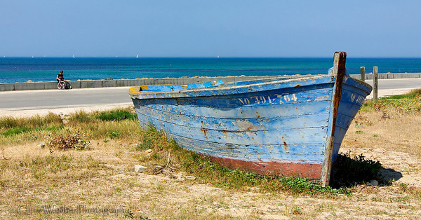 Old blue wooden boat on dry land.  Apparently abandoned on the island of Noirmoutier, France.