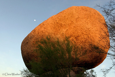 Moon rising over a balancing boulder, Arizona.