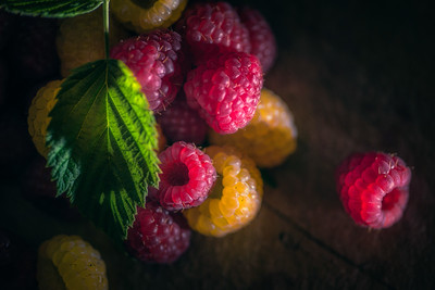 Raspberries by Candlelight Frambozen bij Kaarslicht | Beautiful Classical Colorful Still Life Scene In Magic Light with Red and Yellow Raspberries on Wooden Vintage Style Table Top Dreamy Fruity Delicious Food Photography